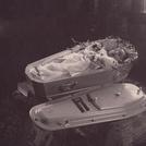 Baby in white coffin