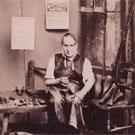 A cobbler mending shoes